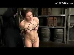 Bondaged girl nipples weights throated pussy fingered in the dungeon