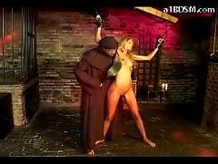Blonde girl with tied arms hanging getting her pussy fucked spnaked tortured with hotwax by monk in the dungeon