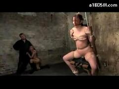 Girl tied to chair sitting on vibrator mouthgag getting whipped by the master lifted up while slave