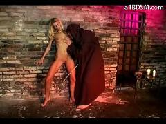 Blonde girl getting her pussy licked fingered spanked with stick tied up by monk in the dungeon
