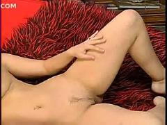 Erica campbell - strip on red sofa