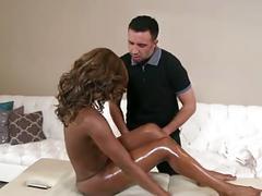 Stunning ebony babe fucks her masseuse