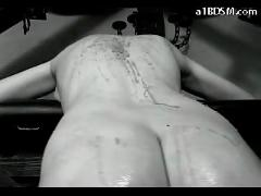 Girl getting her back tortured with hotwax whipped by hangman in the castle