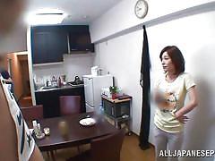 Japanese milf slurps on cock