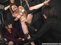 Japanese sex slave in suspension dominated by femdom with electrostim
