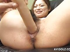 Beautiful japanese babe gets stuffed with many thick dildos