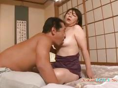 Mature woman getting her hairy pussy fucked with toy by her husband on the mattress