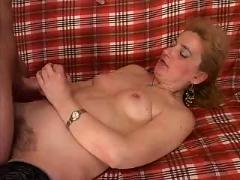 Blonde mature with young man