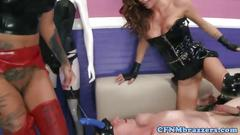Fetish loving sluts play with a strapped cock