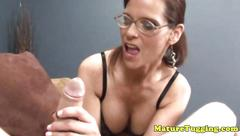 Mature cougar with spex gets a mouthful