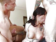 Tatooed whore filled with two cocks