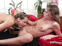 Horny lesbians pissing and having fun