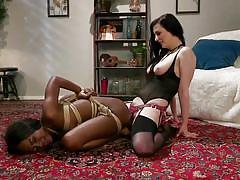 Ebony chick gets nailed hard by the horny brunette