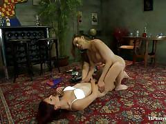 Redhead and shemale fucking lustfully on the carpet