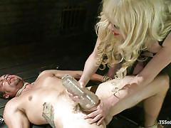 Blonde shemale punishes a tied gay in dark vault
