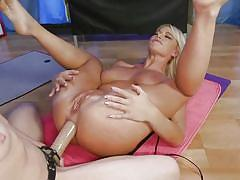 Busty lesbian milf gets a huge strapon deep in her asshole