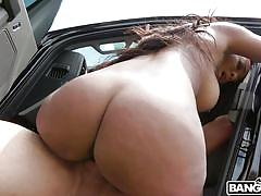 Busty ebony gets fucked in the car