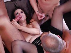 Busty mature in a wild gang bang