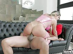 Two strong studs satisfying a busty milf