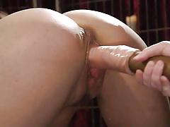 Busty mistress fucks kimber woods with a huge dildo
