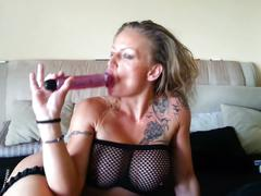 Deep dildo in her mouth