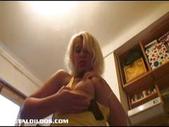 Blonde with big natural tits gaped by a brutal dildo