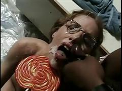 Nerdy lolipop girl gets bukkake