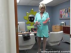 Busty milf swallows cum at the office