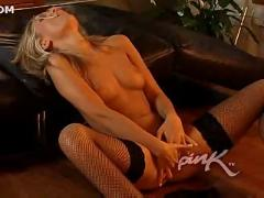 Smoking hot blonde masturbating on the sofa