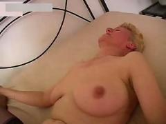 Busty granny in stockings fucks