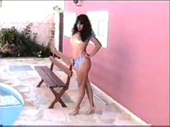 Latin milf nude by the pool