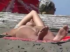 Nudist girl on nude beach