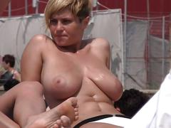 Women with huge tits topless on the beach 2