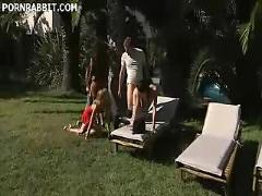 Steamy group sex under the sun