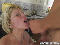 Filthy granny sits on young cock