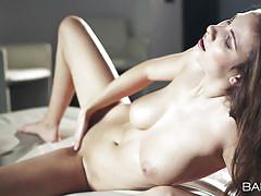Incredible beauty masturbates furiously