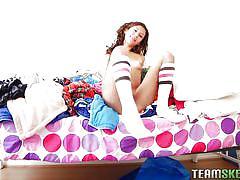 Cutie in socks rubs her womb