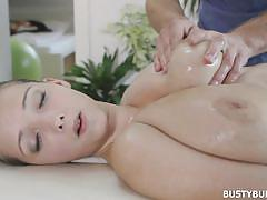Busty gets her boobs covered in oil