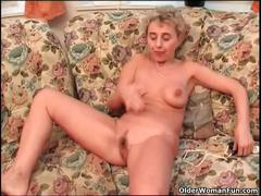 Busty granny finger fucks her old pussy and ass