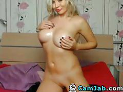 Gorgeous blonde plays her pussy
