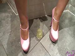 British blonde babes enjoys some peeing action in the bathroom