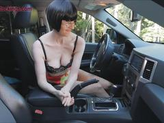 Mature lady masturbates in car at the side of the highway