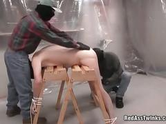 Horny guy is tied and fucked in threesome.