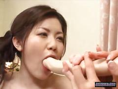 2 asian women play with a double dildo