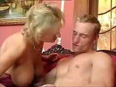 Busty mature in stockings likes to fuck