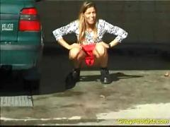 Crazy pee girl at the car wash