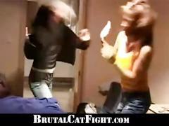 Irritated blonde cat fights hard a cheeky brunette