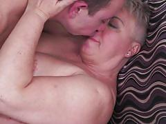 Sexy granny rides a fat dick