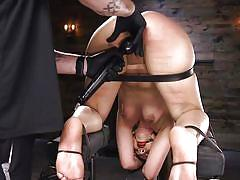Tied-up slave enjoying intense orgasms after brutal punishment