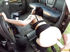 Sexy asian babe gets fucked in a fake taxi